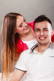 Woman kissing man. Happy couple. Love. Royalty Free Stock Photography