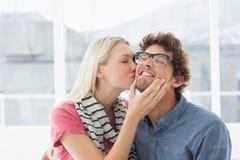 Woman kissing man on his cheek Royalty Free Stock Photos