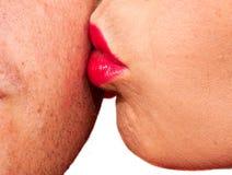 Woman kissing man's cheek Royalty Free Stock Image