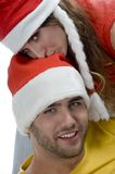 Woman kissing on man's head Stock Photo