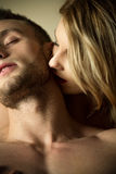 Woman kissing neck Stock Images