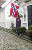 Woman kissing the Norwegian flag Stock Photos