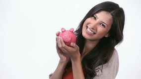 Woman kissing a piggy bank Stock Photography