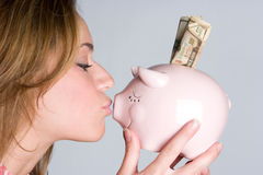 Woman Kissing Piggybank Stock Image