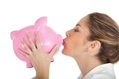 Woman kissing a piggybank Royalty Free Stock Image