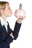 Woman Kissing Piggybank Stock Photography
