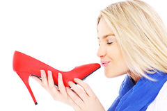 Woman kissing red heels Stock Photo