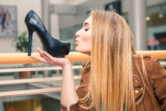 Woman kissing shoe. Women loves shoes concept Royalty Free Stock Photos