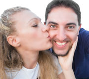 Woman kissing a smiling man. Portrait of a woman kissing a smiling man Royalty Free Stock Photos