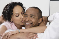Woman Kissing Smiling Man Stock Photography