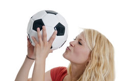 Woman kissing soccer ball Stock Images