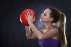 woman kissing soccer ball Royalty Free Stock Image