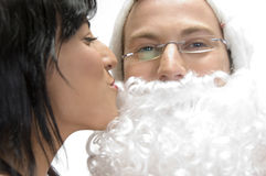 Woman kissing to santa man. Against white background royalty free stock images