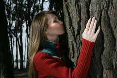 Woman kissing a tree Royalty Free Stock Photography