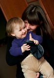 Woman kissing young sister Stock Photography
