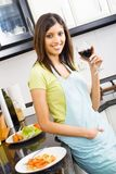 Woman in kitchen stock images