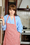 Woman on a kitchen Royalty Free Stock Photography