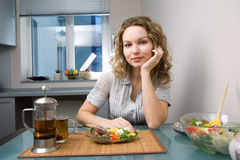 Woman on kitchen Stock Photography