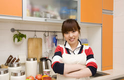 Woman in the kitchen royalty free stock photo