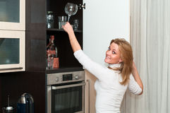 Woman in kitchen. Beautiful happy smiling woman in kitchen interior. One person only Stock Image