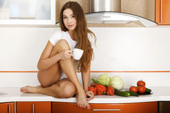 Woman in the kitchen. Stock Photos