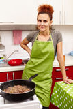 Woman in the kitchen Stock Photos