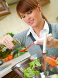 Woman in Kitchen Stock Image