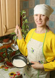 The woman in the kitchen. The woman is engaged in homework in the kitchen Stock Photography