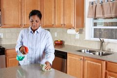 Woman In Kitchen Stock Photo
