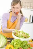 Woman in kitchen Stock Photos