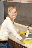 The woman on kitchen Stock Photography