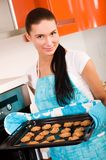 Woman in the kitchen baking cookies. Royalty Free Stock Images