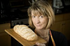 Woman in Kitchen with Bread Royalty Free Stock Images