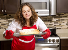 Woman in the kitchen Royalty Free Stock Image