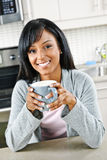 Woman in kitchen with coffee cup Royalty Free Stock Photos