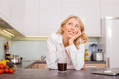 Woman in the kitchen with coffee daydreaming Royalty Free Stock Photos