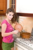 Woman in the kitchen cooking Royalty Free Stock Images