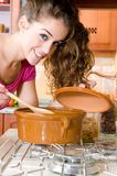 Woman in the kitchen cooking Royalty Free Stock Image