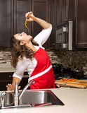 Woman in the kitchen Stock Photography