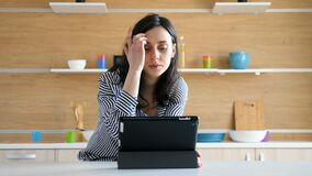 Woman at the kitchen with a digital PC stock video