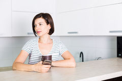 Woman in the kitchen Stock Photo