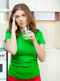 Woman in kitchen Stock Photography