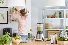 Woman in kitchen. Woman in her eco,bio and modern kitchen royalty free stock images