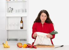 Woman in the kitchen with her food shopping. Woman forgotten things by food shopping Stock Photography