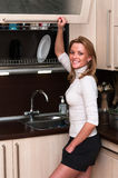 Woman in kitchen interior Stock Image