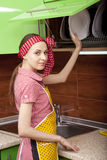 Woman in kitchen interior with clean plates royalty free stock photography