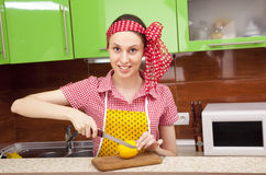 Woman in the kitchen with knife and lemon Royalty Free Stock Photography