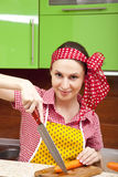 Woman in the kitchen with knife and vegetables Stock Photo