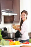 Woman in kitchen making food Stock Photo