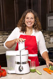 Woman in the kitchen Royalty Free Stock Photos